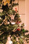 Christmas tree by door — Stock Photo
