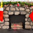 Stock Photo: Christmas stockings above fireplace