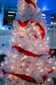 Pink ribboned christmas tree — Stock Photo