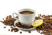 Cup of coffee with lemon and grains — Stock Photo