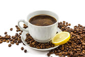 Cup of coffee with grains — Stock Photo