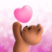 Teddy bear with love heart — Stock Photo