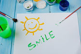 Smile words in a white sheet — Stock Photo