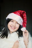 Santa smiling girl — Stock Photo