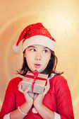Christmas present girl — Stock Photo