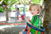 Swinging at playground — Stock Photo