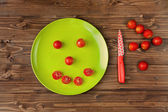 Happy cherries tomatoes — Stock Photo