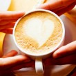 Сup of coffee in hand lovers — Stock Photo