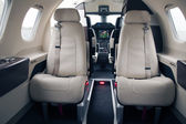 Embraer Phenom 100 passenger cabin — Stock Photo