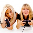 Two happy girls play video games — Stock Photo #15407973
