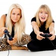 Two girls play video games — 图库照片