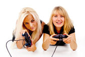 Two happy girls play video games — Stock Photo