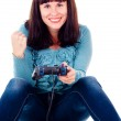 A girl playing video games, rejoicing the victory — Stock Photo #15428167