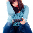 A girl playing video games, defeat — Stock Photo #15428169