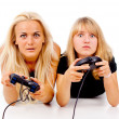 Beautiful girls excitedly play video games - Stock Photo