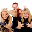 The three girls play video games - Stock Photo