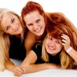 Royalty-Free Stock Photo: The three girls lie on the floor