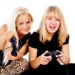 Two girls play video games — Stock Photo