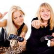 Two happy girls play video games — Stockfoto