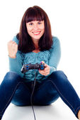A girl playing video games, rejoicing the victory — Stock Photo