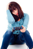 A girl playing video games, defeat — Stock Photo