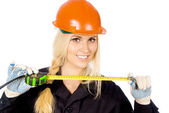 Beautiful girl Builder keep roulette — Stock Photo