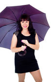Beautiful girl under the umbrella of — Stock Photo