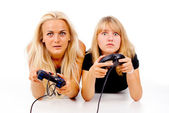 Beautiful girls excitedly play video games — Stock Photo