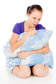 The sick girl was sitting with a pillow — Stock Photo