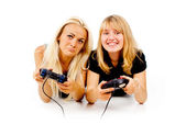The two girls are unhappy with video games — Stock Photo