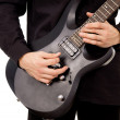 Beautiful guy is playing the electric guitar, large-plan — Stock Photo #15627675