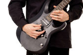 Beautiful guy is playing the electric guitar, large-plan — Stock Photo