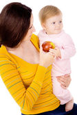Mom and little boy lead the healthy way of life, and eat apples — ストック写真