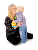 Mom kissed the little baby — Stock Photo
