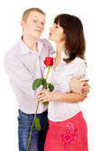 The girl thanked the guy for the rose — Stock Photo