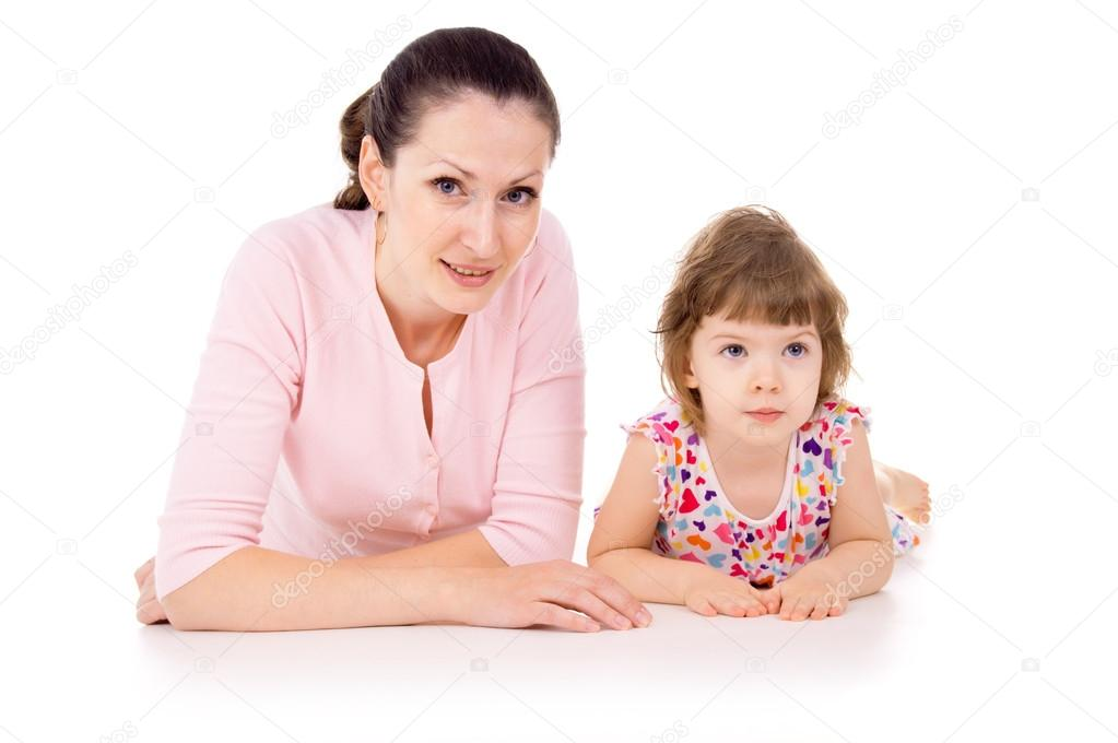 Mom lies is with a small beautiful child isolated on white background — Stock Photo #15628027