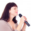 Beautiful girl singing into the microphone — Stock Photo