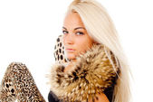 Beautiful blonde girl posing with fur on his neck, portrait — Stok fotoğraf