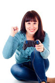 Beautiful girl happy, playing video games — Stock Photo