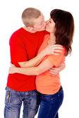 Una famiglia felice, una coppia, baciare — Foto Stock