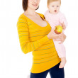 Mother is feeding a baby apples — Stock Photo #16795381