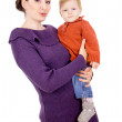 Mother tenderly holding the baby in her arms — Stock Photo #16795445