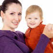 Mother tenderly holding the baby in her arms — Stock Photo