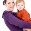 Mother tenderly holding the baby in her arms — Stock Photo #16795457