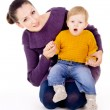 The mother sitting and keep child in your arms — Stock Photo #16795705