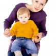 The mother sitting and keep child in your arms — Stock Photo #16795707