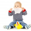 Little baby get wet wipes, and wipes his face — Stock Photo