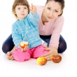 Mother and daughter eat apples — Stock Photo #16796675
