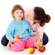 Royalty-Free Stock Photo: Mom with daughter having a healthy way of life, and eat apples
