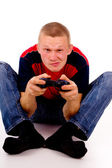 The guy excitedly playing video games — Стоковое фото